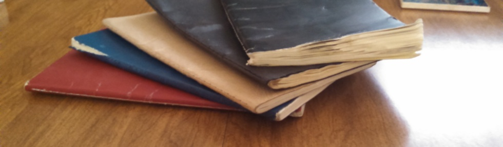 Pile of well worn notebooks